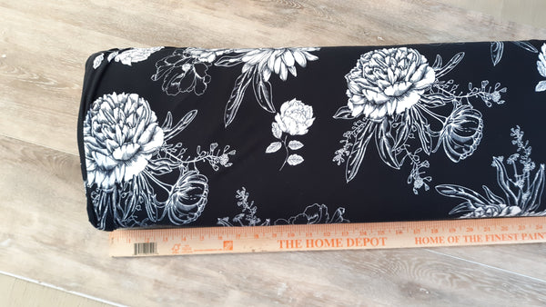 Double Brushed Poly Black with White Floral  |By the Half Yard