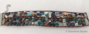 Multi-colored beaded leather bracelet