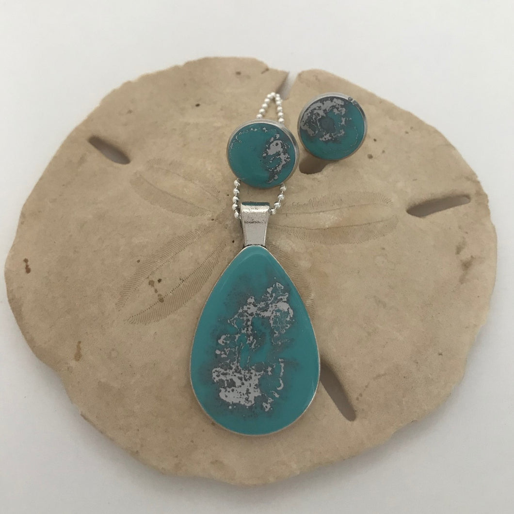 Turquoise and silver colored necklace and earrings set