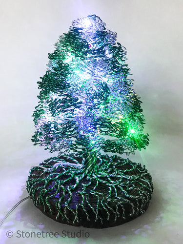 Green and silver lighted Christmas tree