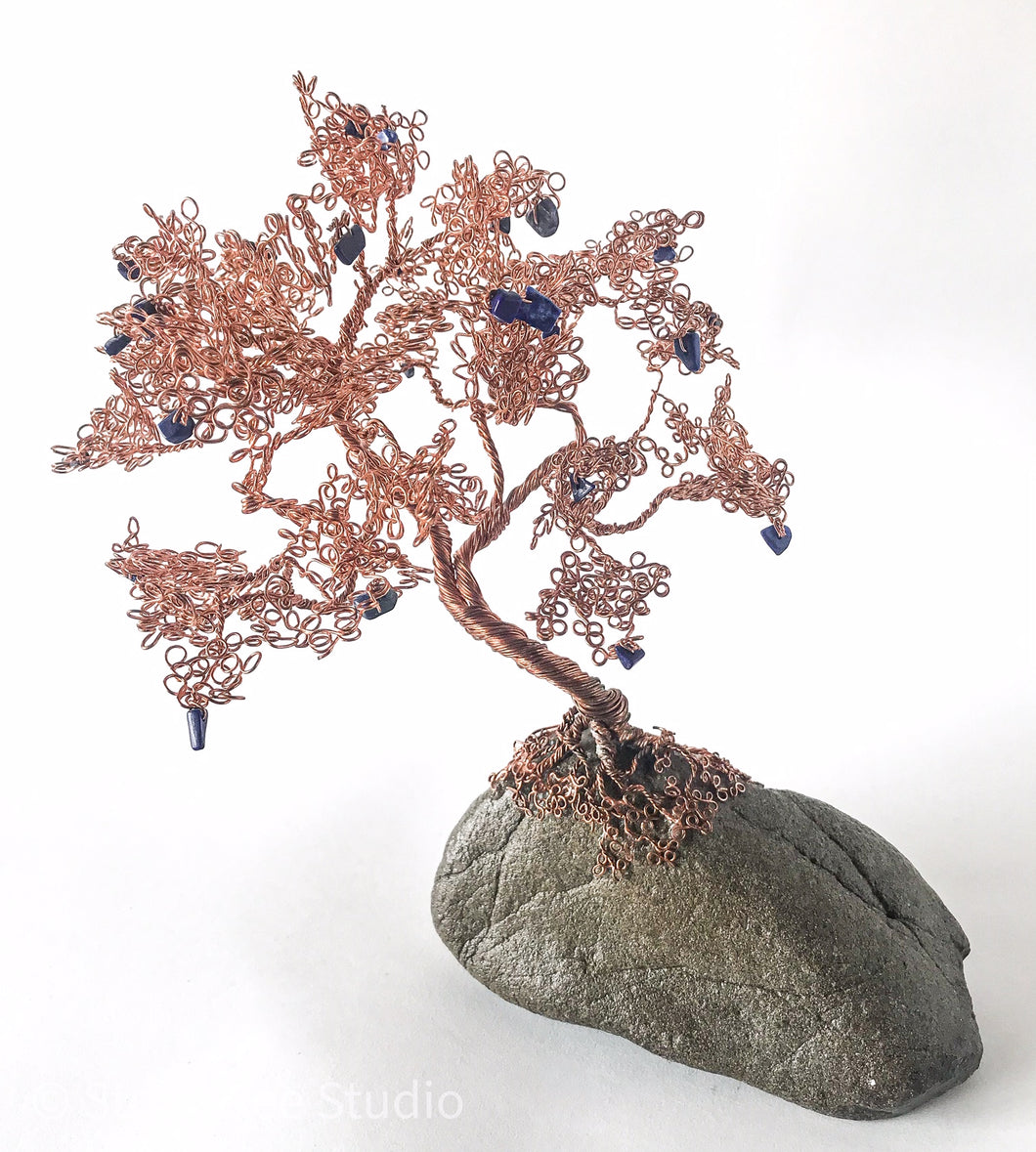 copper oak on rock with lapis