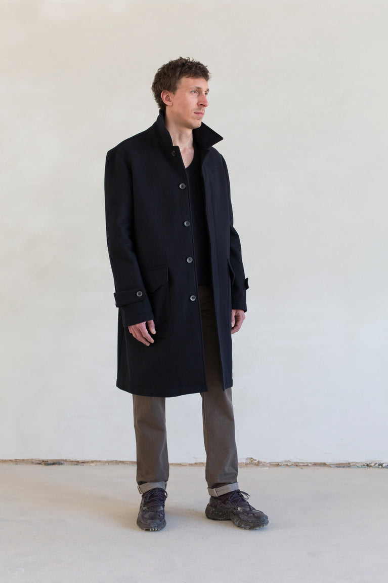 7d collection , 7d , belgian brand , ikkoopbelgisch , cotton lined coat with patch pockets in heavy wool v-neck sweater in supersoft merino rib knit regular fit five pocket pant in japanese colour denim