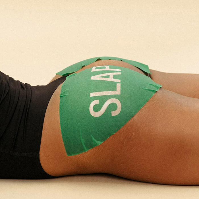 Two green butt sheet masks on a woman's bare buttocks