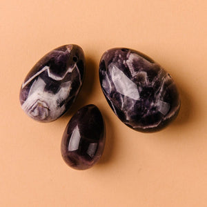 Set of three yoni eggs of different sizes for kegel exercises made our of natural amethyst crystal