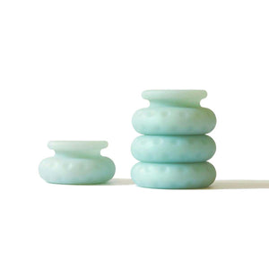 Set of stacked jade-coloured Ohnut rings for customisable penetration depth