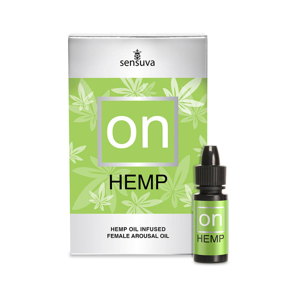 Green bottle of natural hemp arousal oil for her and its green packaging