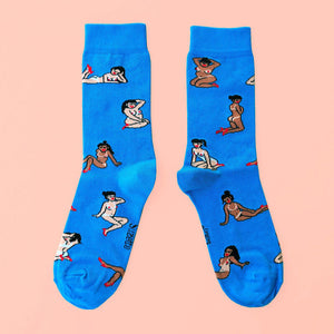 Flat view of two blue socks printed with girls