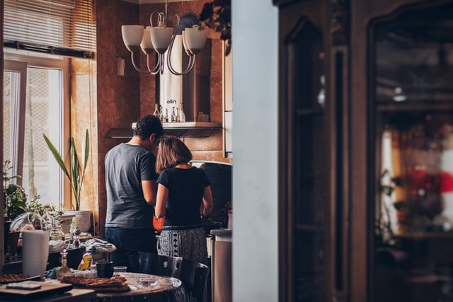 a couple standing at the stove