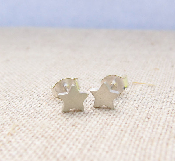 Sterling Silver Star-Shaped Stud Earrings on Flat Surface