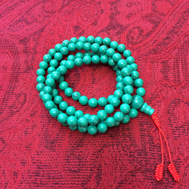 Turquoise Malas With Red Tassle