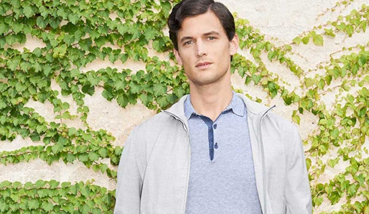 Image of man wearing a polo shirt and jacket from Canali