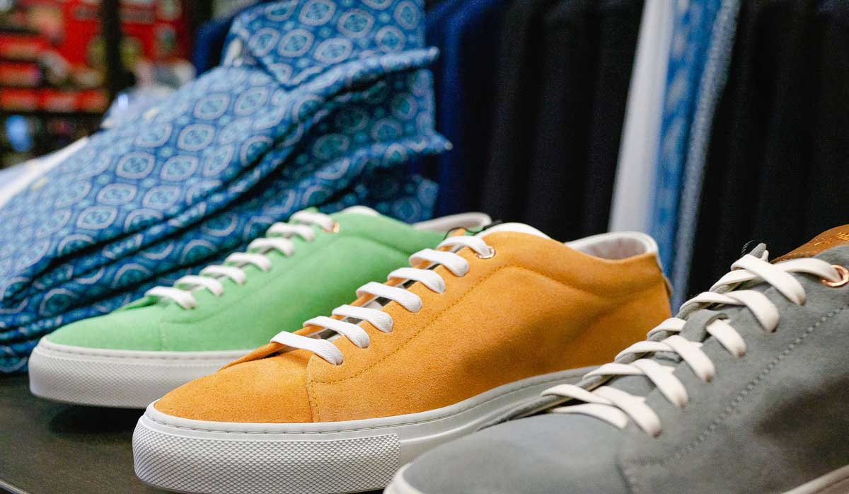 Image of three different colour sneakers lined up right next to eatch otehr