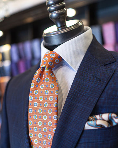 Picture of ZZegna Navy Glencheck Suit with Canali Orange Medallion Tie on a mannequin