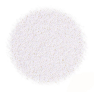 All Natural Sprinkles: White Nonpareils | www.bakerspartyshop.com