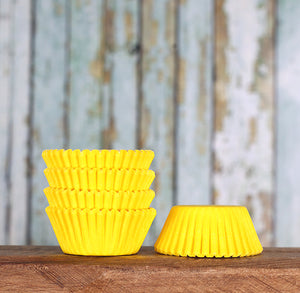 Bulk Mini Yellow Cupcake Liners: Solid | www.bakerspartyshop.com