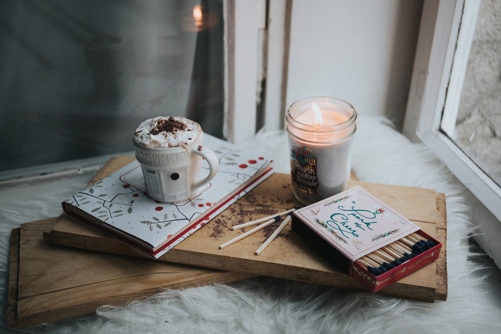 candle and hot chocolate in window