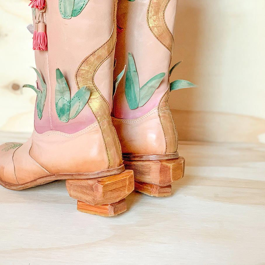 heel view of handmade cowboy boots with native australian flower detailing and rock shaped heels