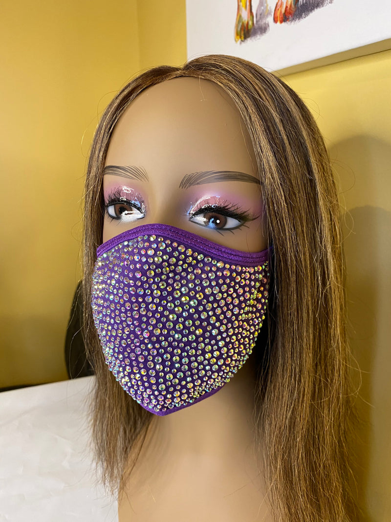 a woman wearing a purple hat and a mask