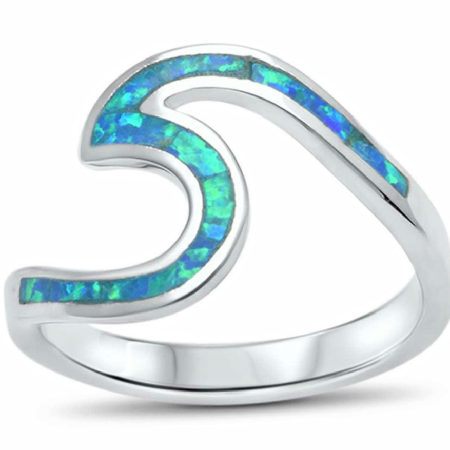 Sail away every day with this fabulous womens blue opal wave ring in sterling silver