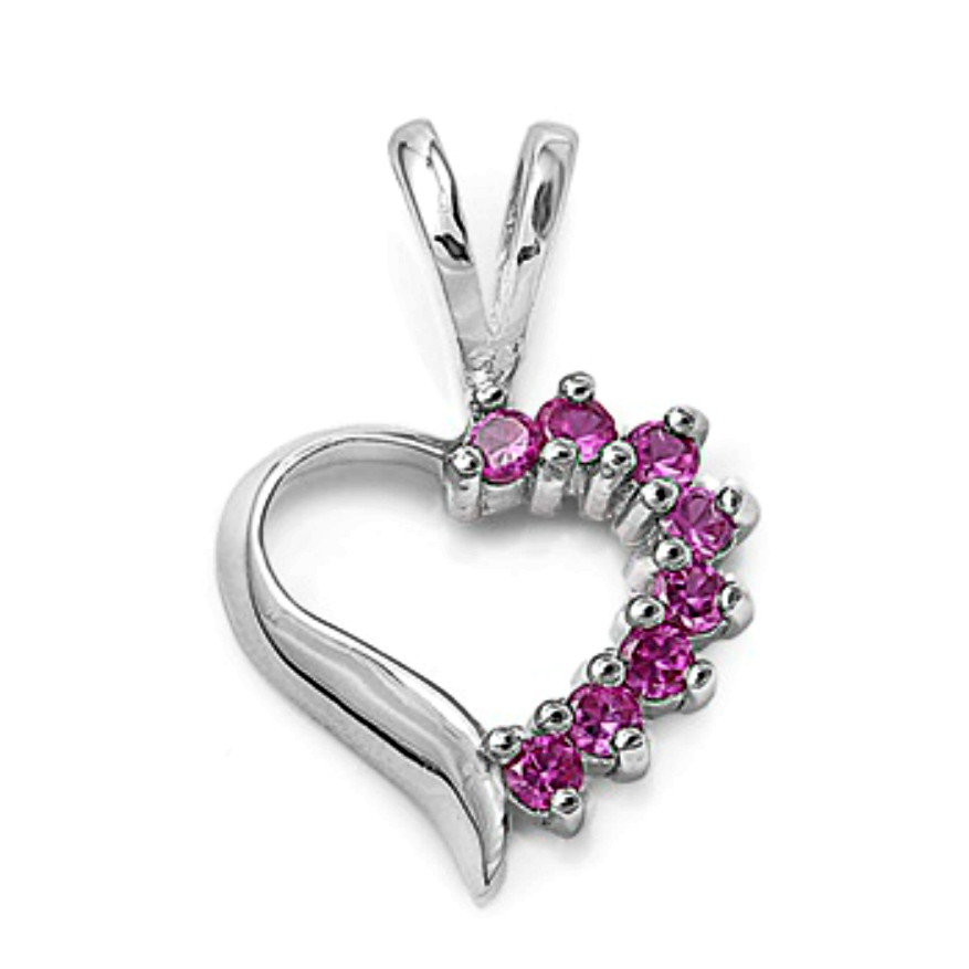 Womens or girls ruby heart pendant in sterling silver