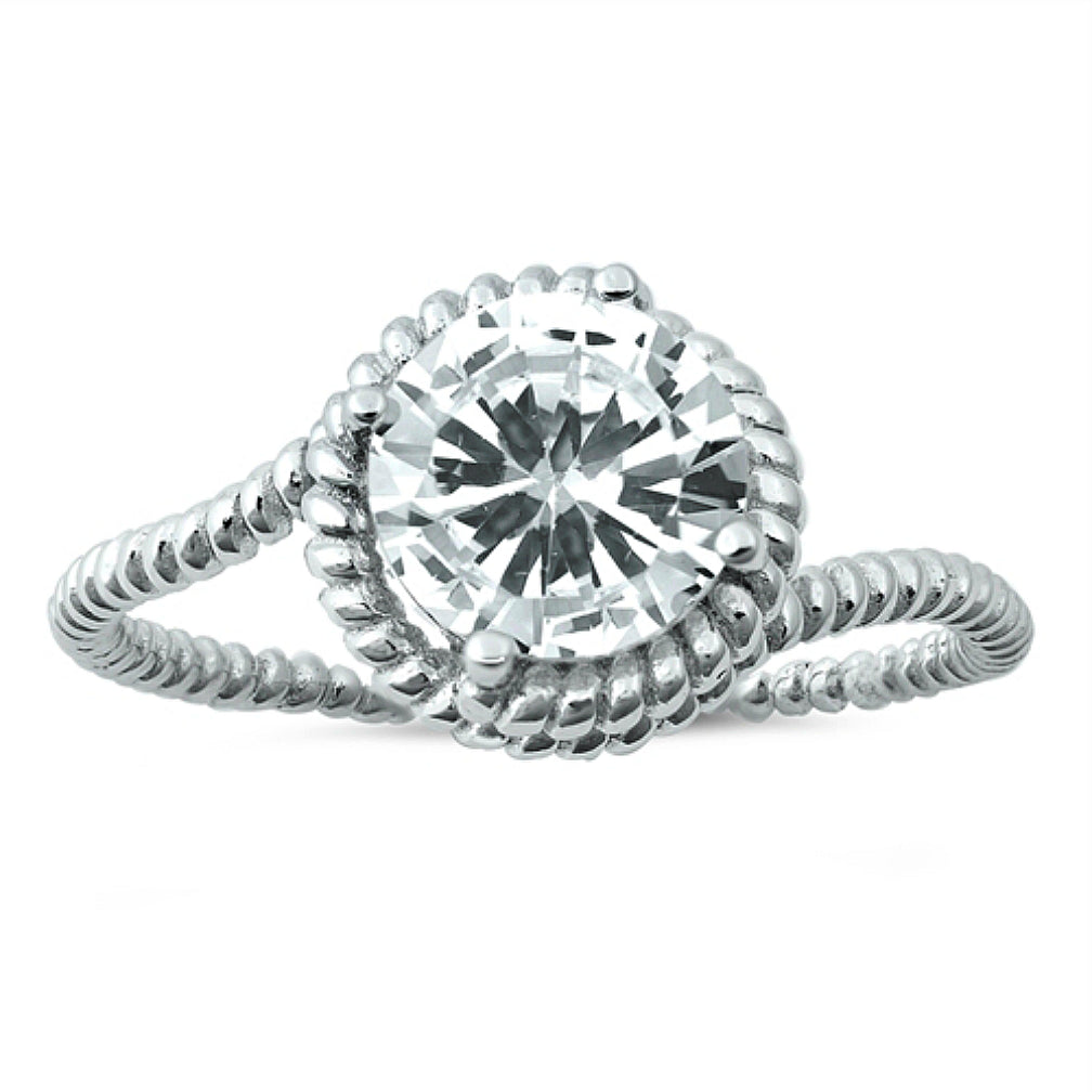 A generously sized 2.5 ct. round cut solitaire ring fits inside this charming rope setting, suitable for her inner cowgirl or fashion queen.