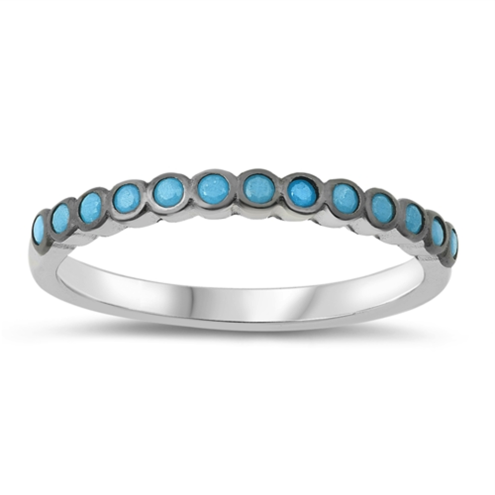 Style: Striking small circles set with blue turquoise gemstones in a black setting  Metal quality: .925 Sterling Silver with stamped hallmark  Color: Blue, Black  Stackable: Yes  Wear as: Ladies Midi, Thumb, Knuckle, Regular fashion  Face height: 10 mm high  Band width: 2 mm  Ring size: 4-10  Packaging: Comes in a pretty gift box  Made in the USA