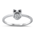 Style: Tiny Cute Owl with black eye gemstone accents  Metal quality: .925 Sterling Silver with stamped hallmark  Color: Silver, Black, Clear White  Stones: AAA Quality Russian Ice Cubic Zirconia  Stackable: Yes  Wear as: Kids fashion, Ladies Midi, Thumb, Knuckle, Regular  Face height: 7 mm high  Band width: 2 mm  Ring size: 5-10  Packaging: Comes in a pretty gift box  Made in the USA