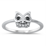 Style: Cute Owl with black eye gemstone accents  Metal quality: .925 Sterling Silver with stamped hallmark  Color: Silver, Black, Clear White  Stones: AAA Quality Russian Ice Cubic Zirconia  Stackable: Yes  Wear as: Kids fashion, Ladies Midi, Thumb, Knuckle, Regular  Face height: 9 mm high  Band width: 2 mm  Ring size: 5-10  Packaging: Comes in a pretty gift box  Made in the USA