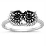 Style: Large Eyed Owl with gemstone and accents  Metal quality: .925 Sterling Silver with stamped hallmark  Color: Silver, Black, Clear White  Stones: AAA Quality Russian Ice Cubic Zirconia  Stackable: Yes  Wear as: Kids fashion, Ladies Midi, Thumb, Knuckle, Regular  Face height: 8 mm high  Band width: 2 mm  Ring size: 5-10  Packaging: Comes in a pretty gift box  Made in the USA