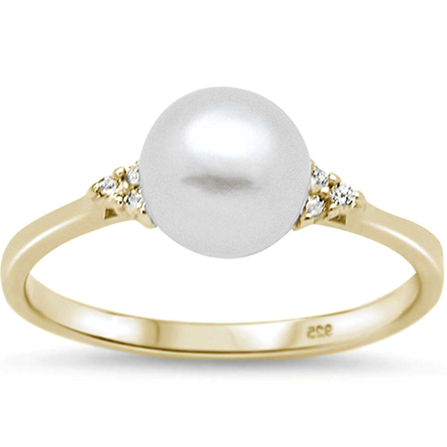 Womens perfect pearl in a warm yellow gold setting with triple gemstones on each side