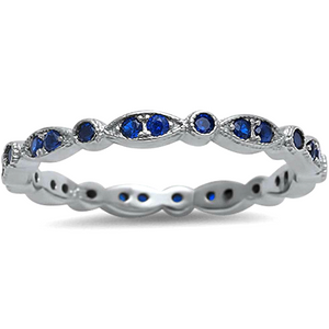 Blue sapphire goes all the way around the eternity band