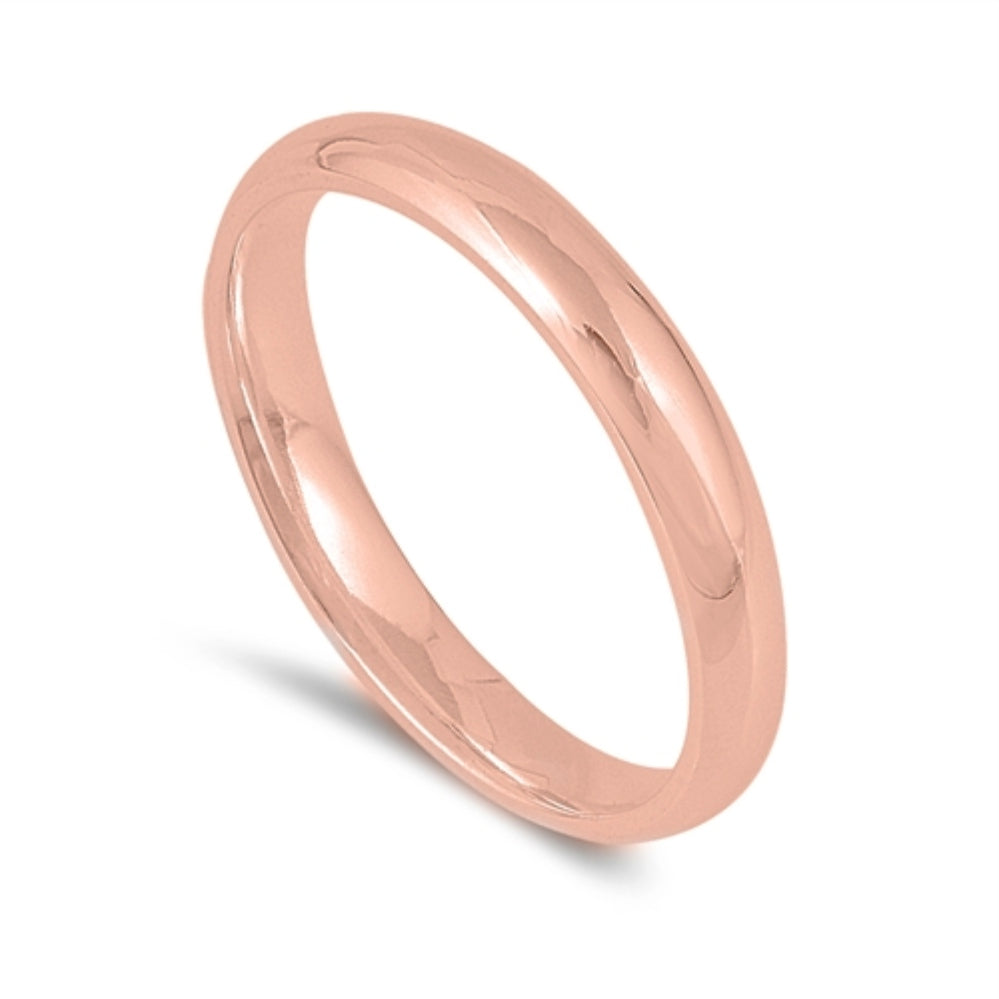 Elegant simplicity in a timeless classic wedding band or fashion ring  Stack this wardrobe staple in various colors as a midi or thumb ring or wear it traditionally  Metal quality: .925 Sterling Silver with stamped hallmark  Color: Rose Gold