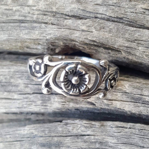 Exquisite swirling vines and leaves showcase an Irish rose.  Wear it for an everyday finger, thumb, or knuckle midi ring.  Metal quality: .925 Sterling Silver with stamped hallmark  Color: Silver  Stones: None  Face height: 7 mm high  Band width: 2 mm band  Kids and Ladies ring size: 4-10