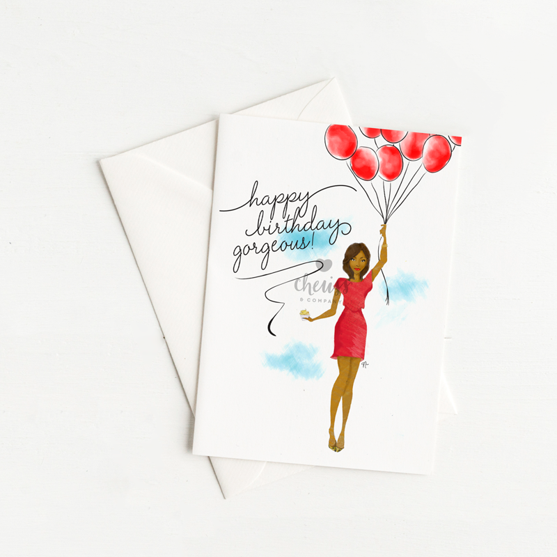 greeting cart with an illustration of an African American woman floating in the sky holding red balloons and a cupcake.
