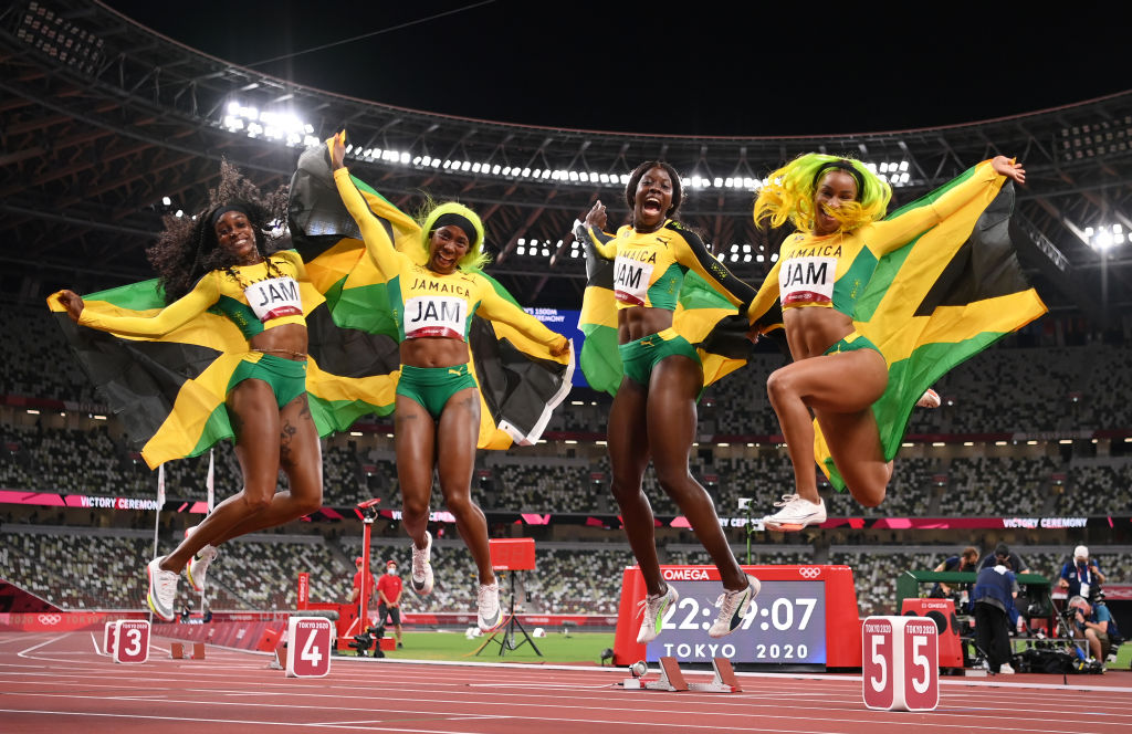 JUMPING FOR JOY: Briana Williams, Elaine Thompson-Herah, Shelly-Ann Fraser-Pryce and Shericka Jackson of Team Jamaica Photo by Matthias Hangst / Getty Images