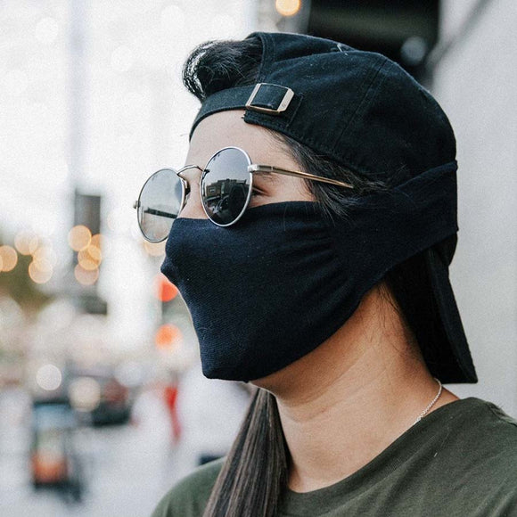 30X Mask, black neck loop mask, being worn in the city