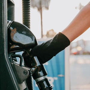 30X SafeSleeve Hand Protector, black antimicrobial hand covering, being used at a gas pump - Added protection for shared surfaces