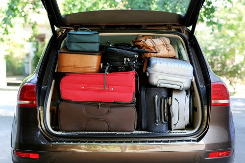 car packed to the maximum with luggage for the upcoming road-trip