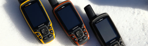Yellow red and black Garmin GPS devices