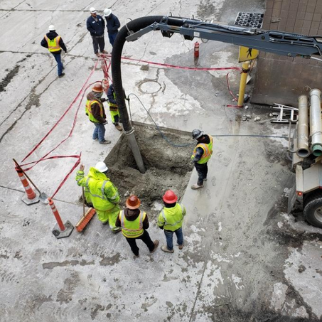 Construction crew working on digging a hole