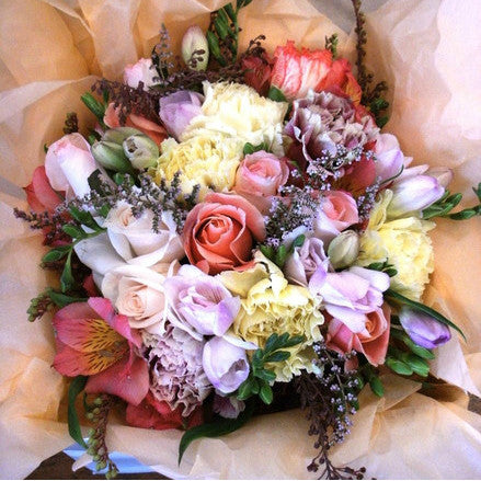 Our most popular arrangement.  A sweet cottage mix of traditional lemons, lilacs, pinks and apricots.