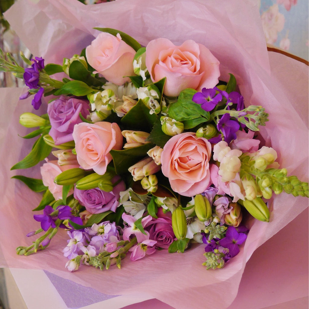 A gentle mix of soft pinks, lilacs and white. Gentle floral bouquet of roses, lilies , stock and alstroemeria flowers