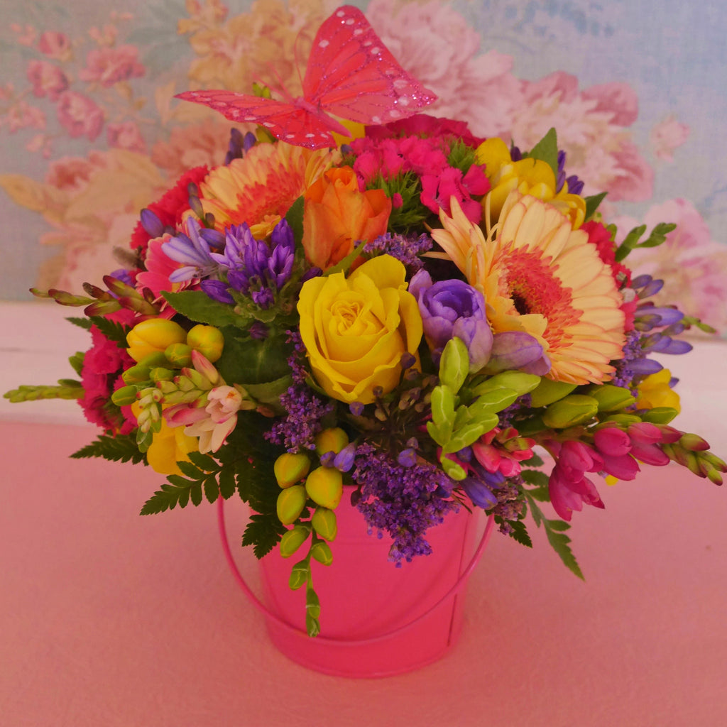 Madame Butterfly. Bright posy in a matching water-filled vase box or if you prefer, a cute tin pail. Butterfly atop.