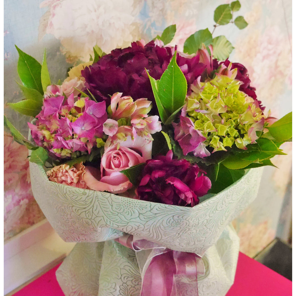 Modern Xmas Colour mix.  Cerise, lime hot pink and mid purples. In a waterbox with mint green wrap