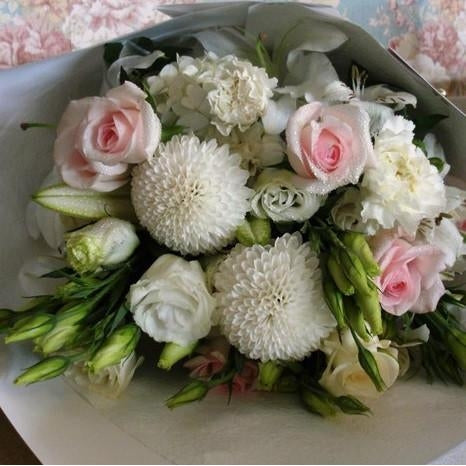 Pearl Lustre Bouquet. A selection of fresh white and pale pink flowers styled together in an elegant bouquet.