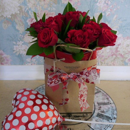 12 Premium Red Roses, wrapped in a Kraft Bag with Heart Ribbon and Polka Dot Heart Balloon