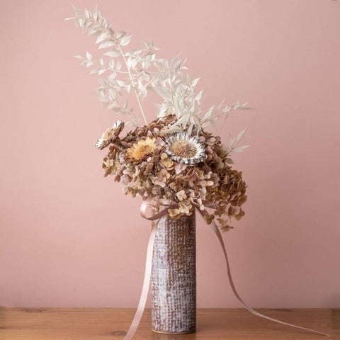 lilac pottery vase and dried flowers