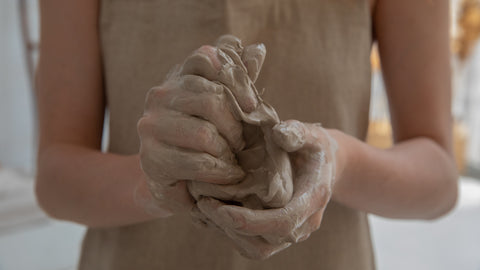 clay hands in pottery class