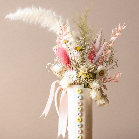 ceramic vase and dried flowers
