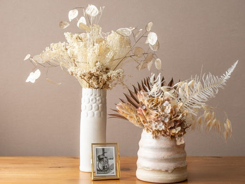 ceramic pottery vases and dried flowers